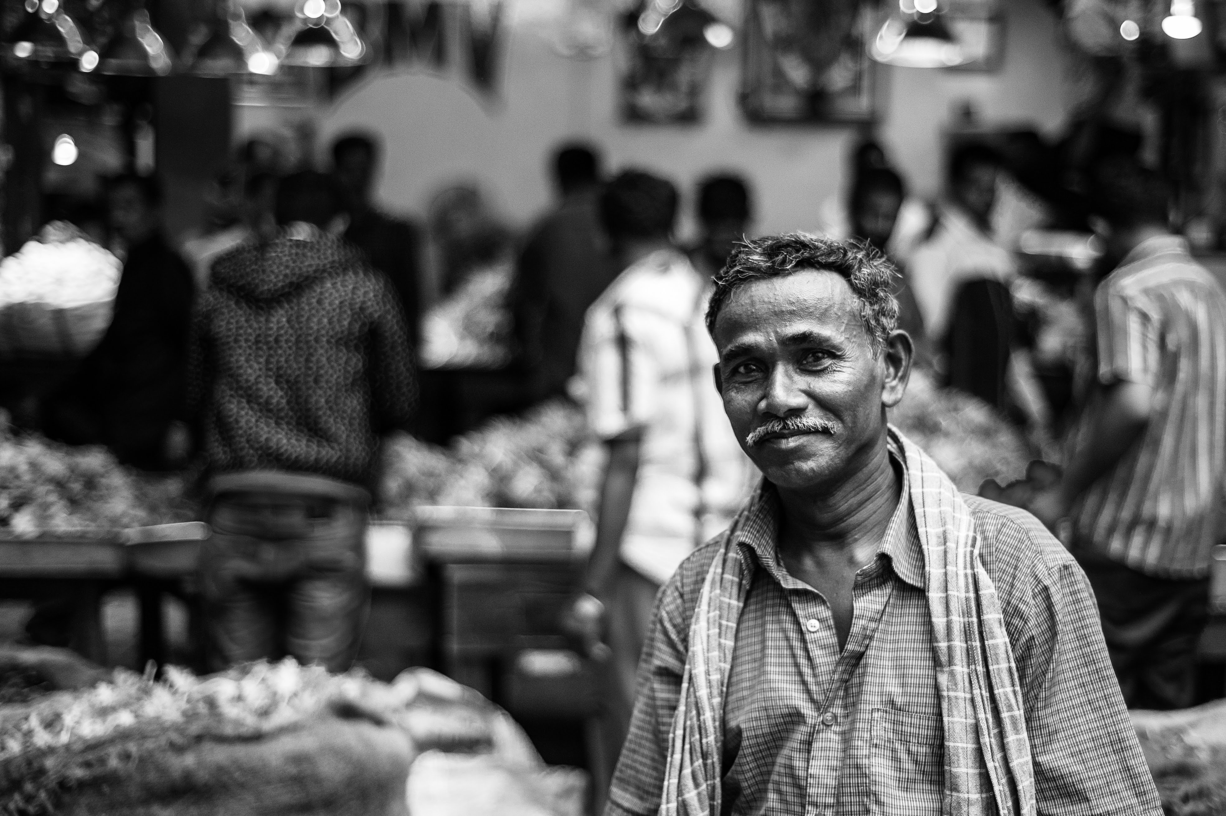A black and white portrait of a manual labourer taking a break.