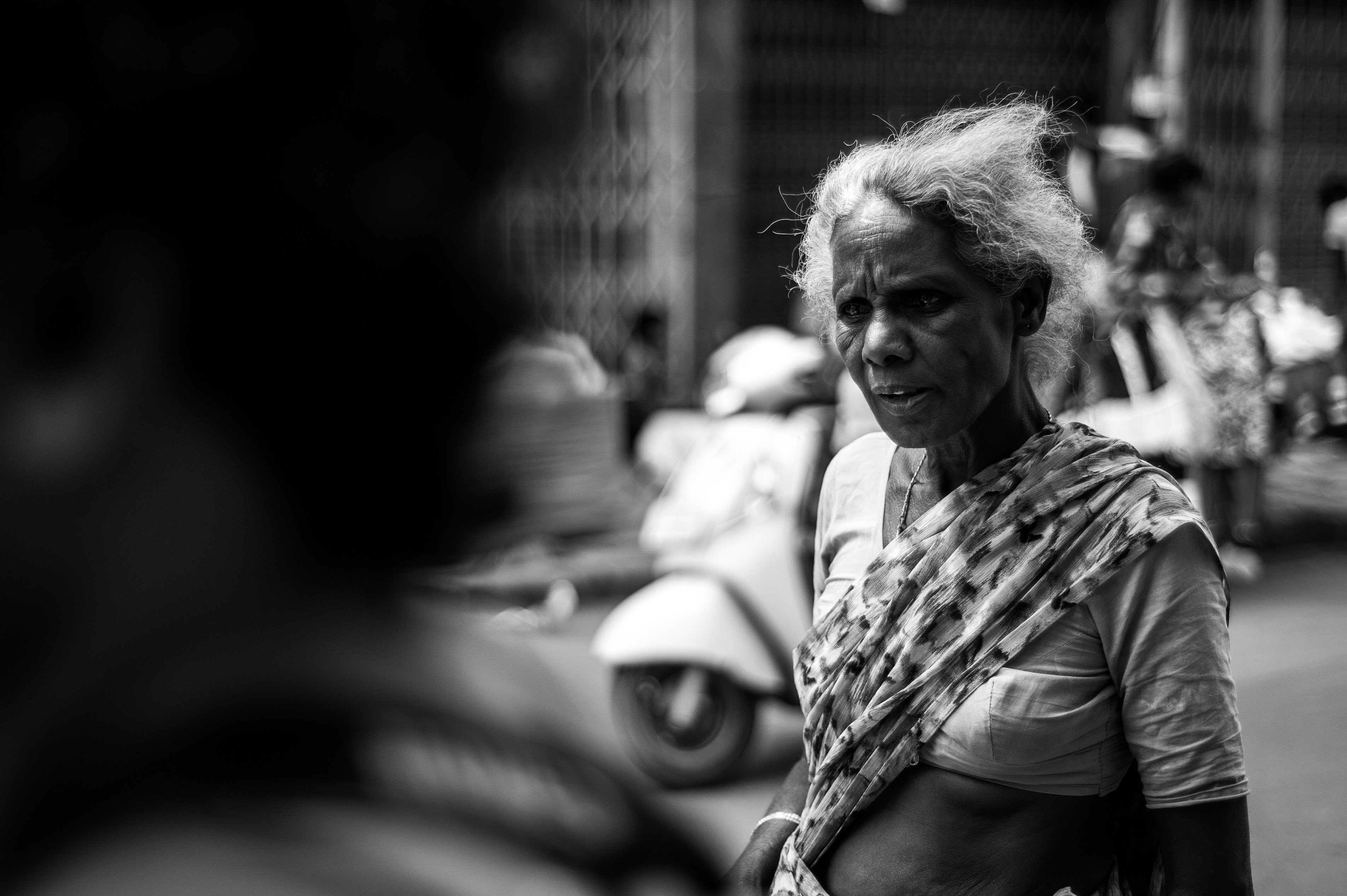 A black and white portrait of a feisty tamarind vendor (female) who didn't like her picture taken.