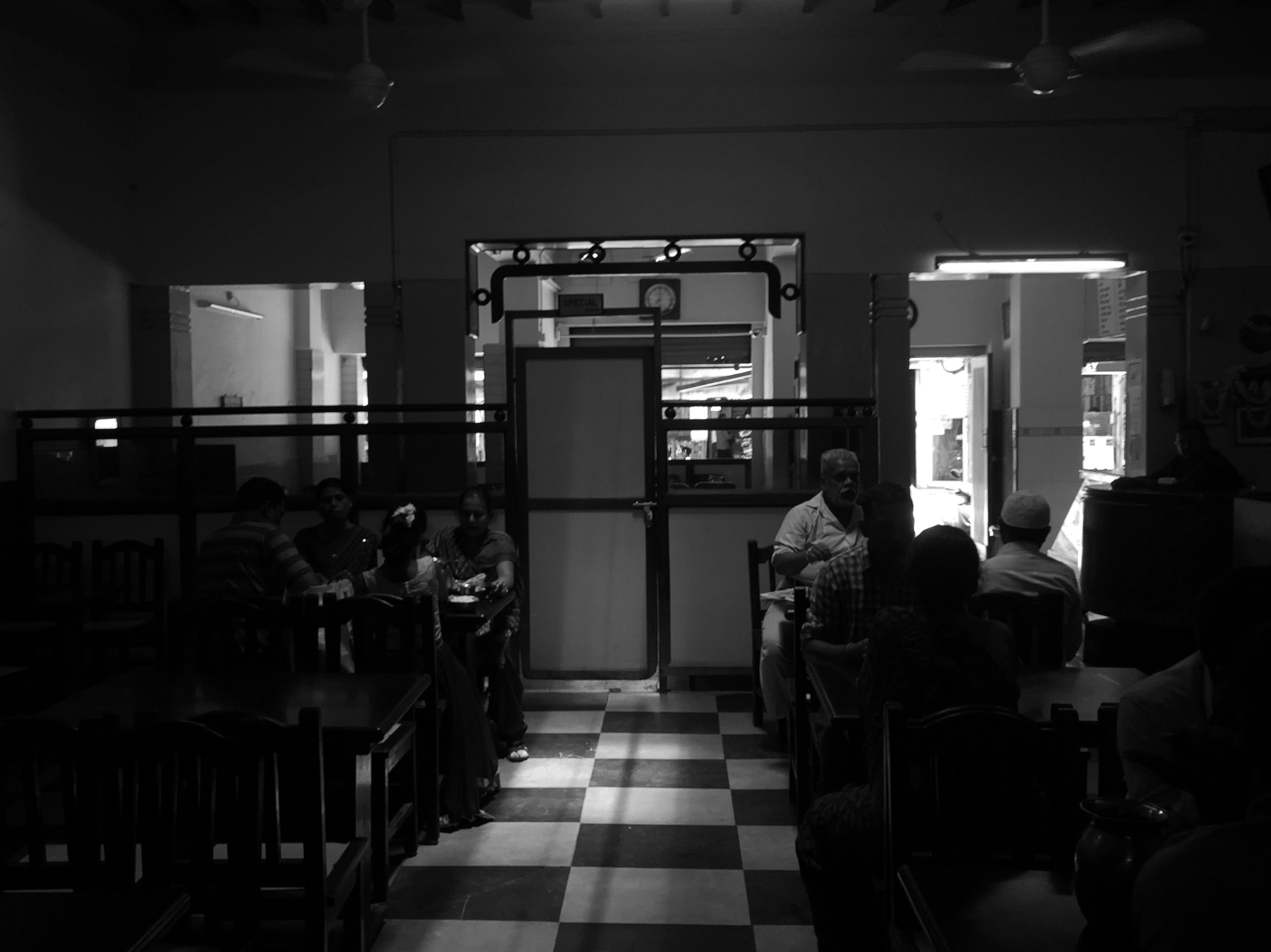 A black and white image of the interiors of Udupi Sri Krishna Bhavan. We ended our walk at this iconic restaurant.