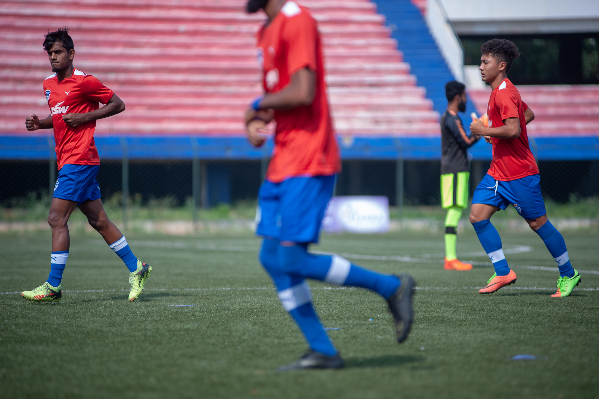 Seen here are three players of the starting XI of Bengaluru FC B warm up before the game.