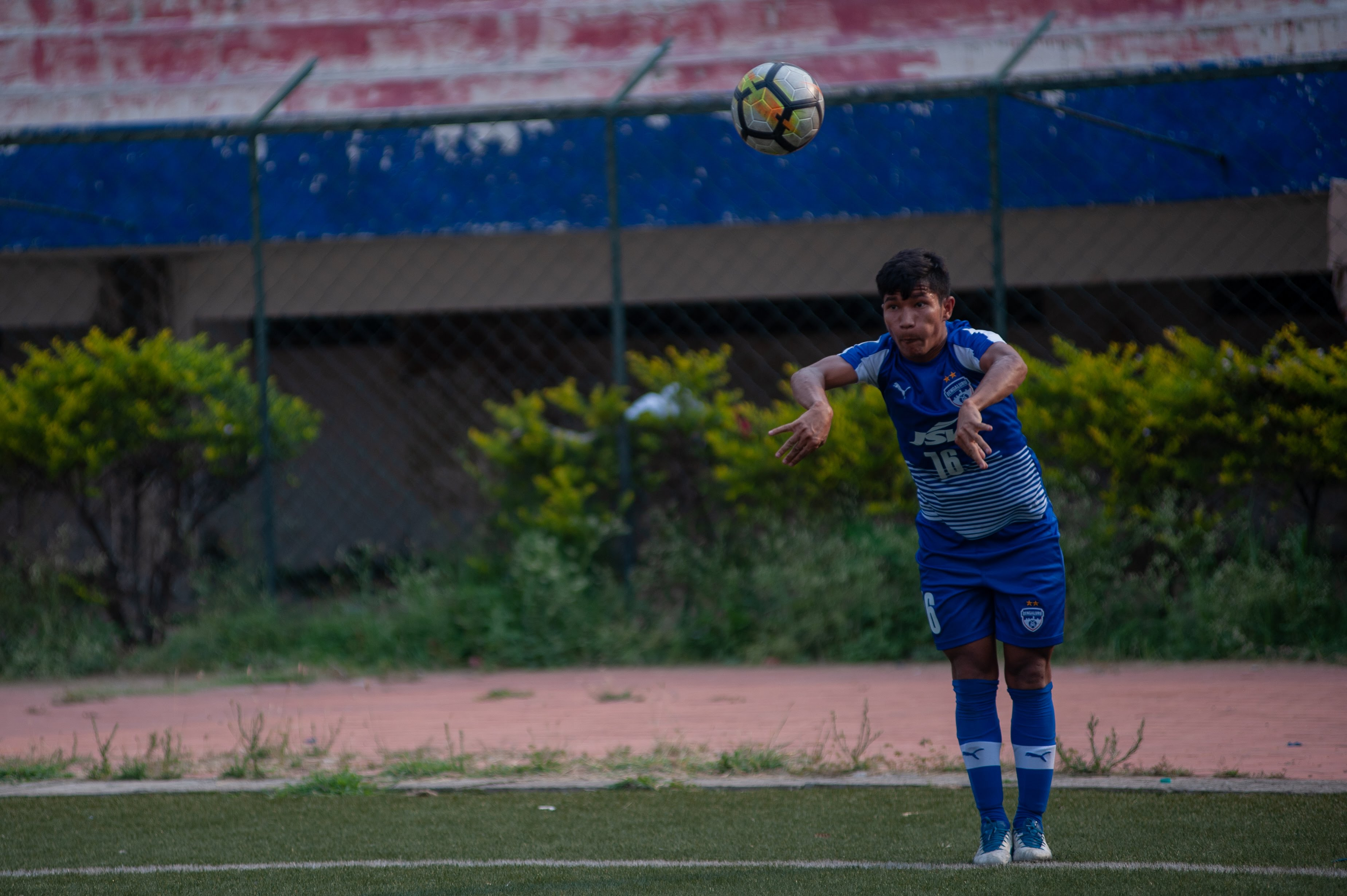 A Bengaluru FC players takes a quick throw in