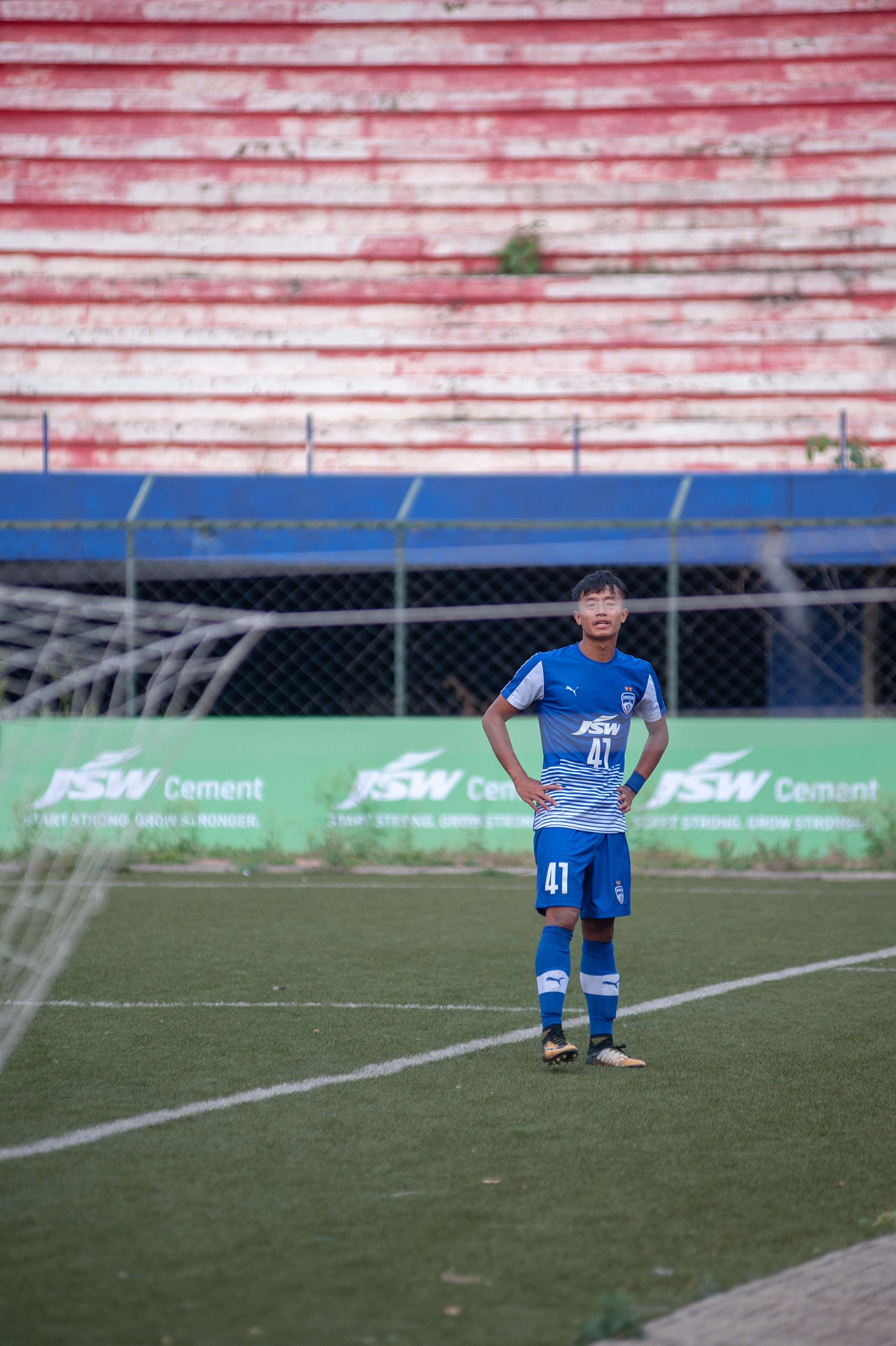 Naorem Roshan is seen standing behind the goal, dejected, after failing to hit the back of the net by a whisker.
