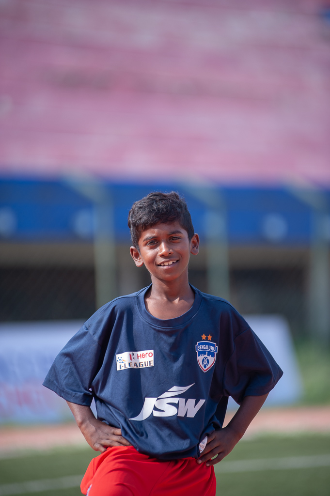 Portrait of another recruit from the Bengaluru FC Soccer Schools who is used as a ball boy for local games.