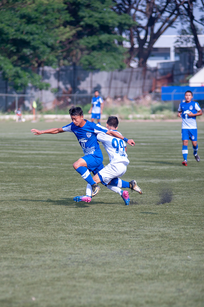 BFC B's Roshan Singh is tackled outside the D by Chennaiyin FC's defender.
