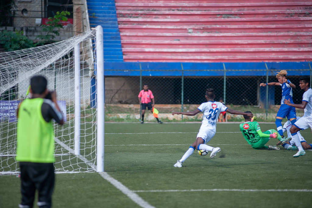 A Chennaiyin defender clear the ball just ahead of the goal line.