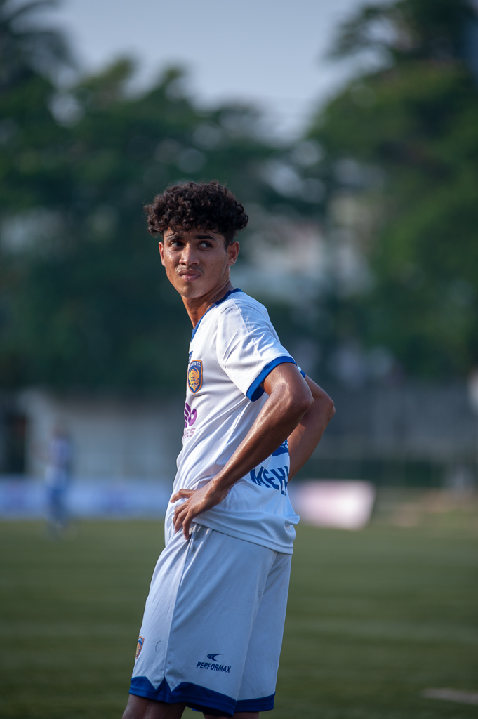 A medium shot of a Chennaiyin FC Reserves defender looks despairingly at the scoreboard behind him.