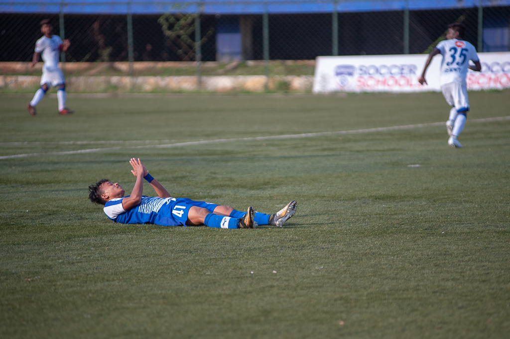 BFC B's Roshan Singh is flat on the ground after sliding to get to the end of a half-chance created by his fellow winger.