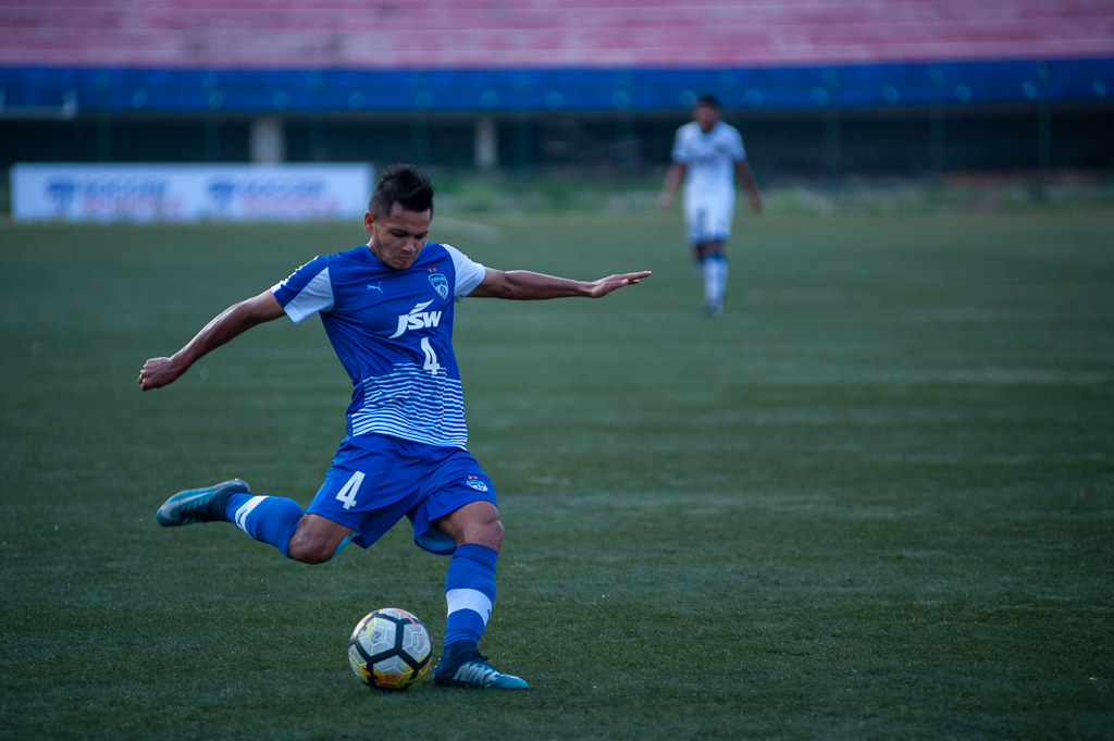 Shot of Nishu Kumar in action. He is seen putting in a cross for what proved to be a 'pre-assist' for BFC B's 5th goal of the evening.