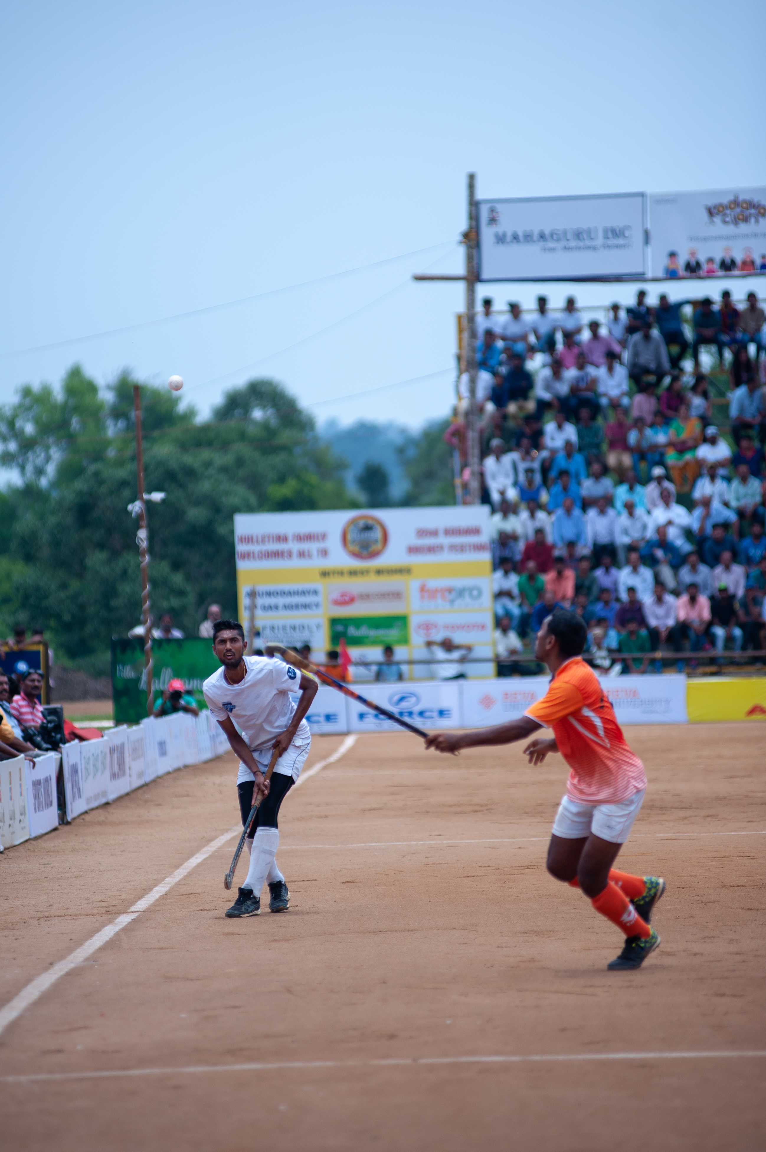 Sonu, a player with the Chendanda family, is seen flicking the ball over the head of an Anjaparvanda midfielder.