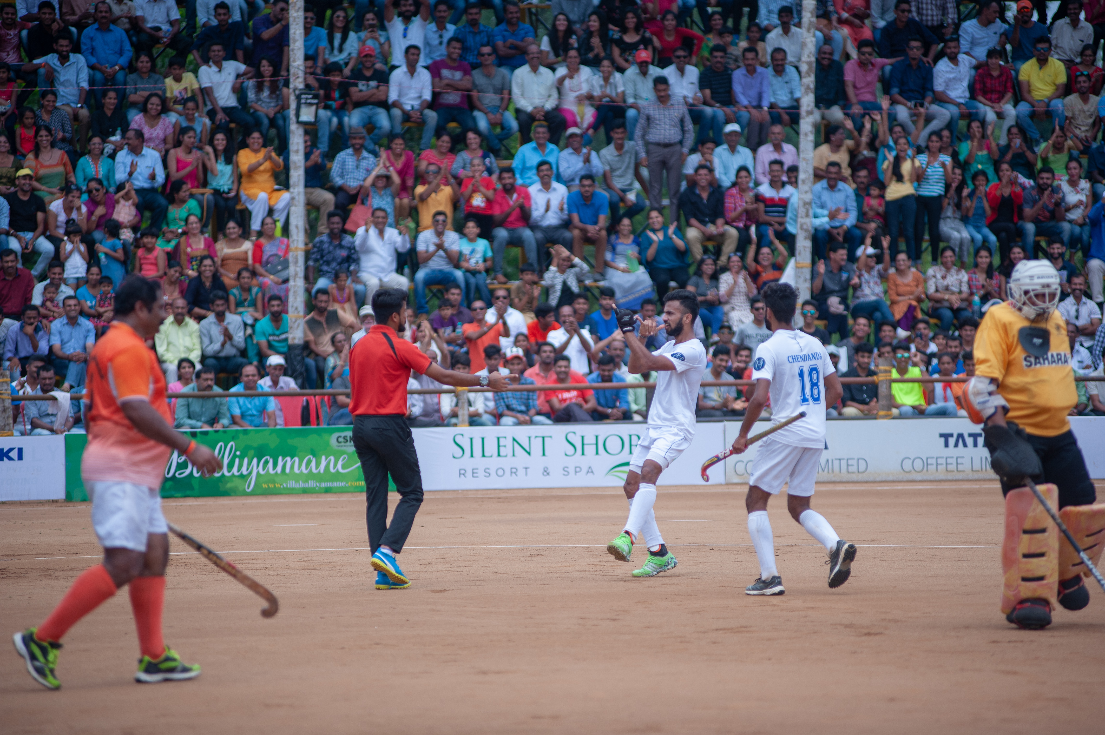 Nikkin Thimmaiah, a former India hockey player, breaks out into a dance in front of the fans after assisting Chendanda's second goal.